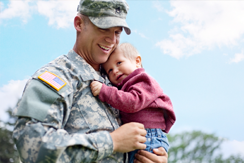 Photo of veteran holding a child